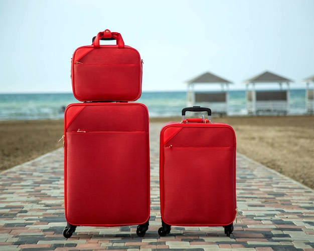 Set of red suitcases and bags Free Photo
