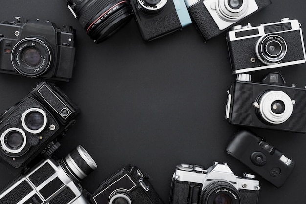 Set of retro photo cameras in circle Free Photo