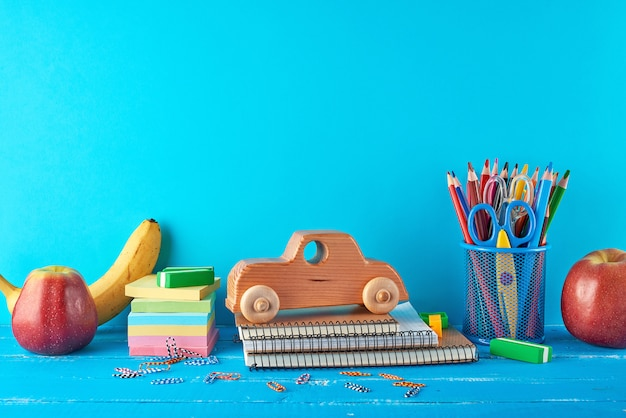 Set of school supplies with notebook, pencils, stickers, paper clips, scissors Premium Photo