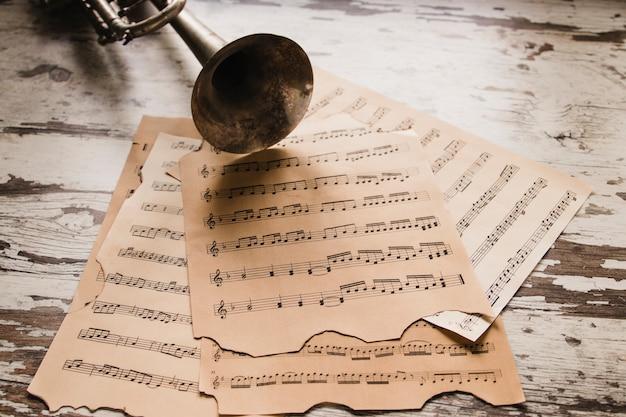 Set of sheet music near trumpet Free Photo