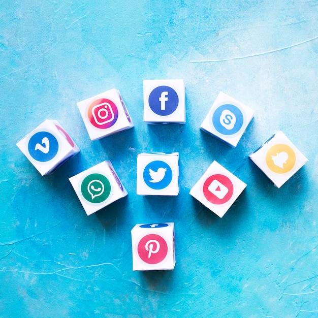 Set of social media icon boxes against painted wall Free Photo