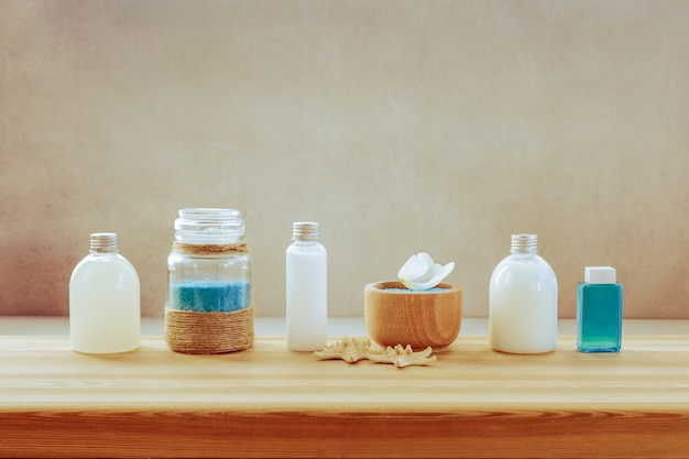 A set of spa products on a wooden shelf Premium Photo