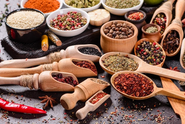 A set of spices and herbs. indian cuisine. pepper, salt, paprika, basil. top view. Premium Photo