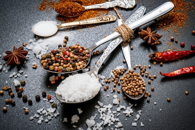 A set of spices and herbs with spoon Premium Photo