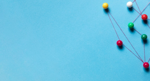 Set of stationery pins and thread blue background Free Photo