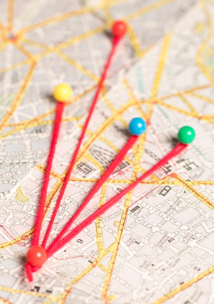 Set of stationery pins and thread and route map Free Photo