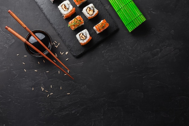 Set of sushi and maki on stone table. top view with copy space Premium Photo