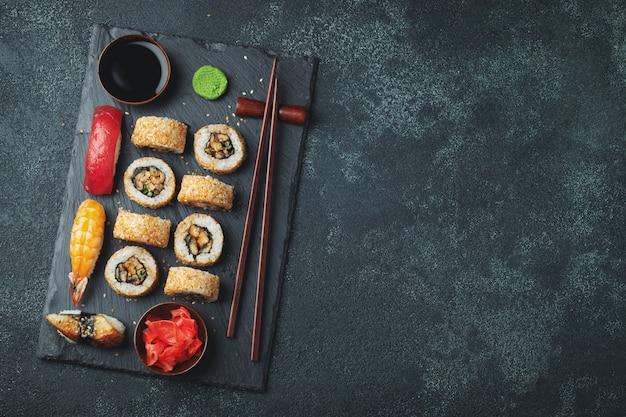 Set of sushi and maki on stone table. Premium Photo