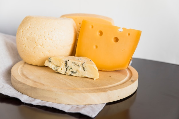 Set of tasty cheese on wooden board Free Photo
