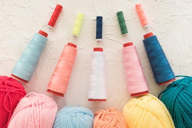 Set of threads near yarn Free Photo