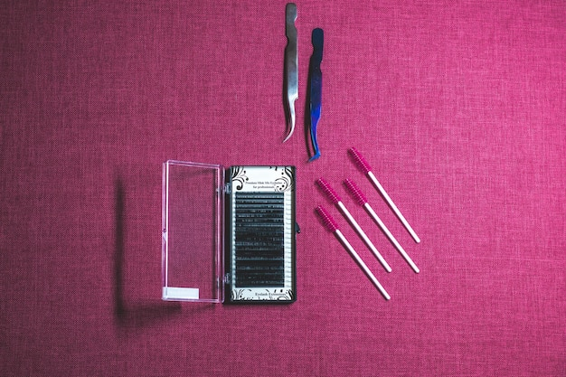 The set of tools for eyes. cosmetical equipment consists of eyelashes brushes, mascara, curler and false eyelashes. Premium Photo