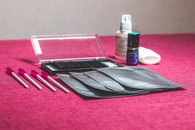 The set of tools for eyes. cosmetical equipment consists of eyelashes brushes, mascara, curler and false eyelashes. Premium Photo
