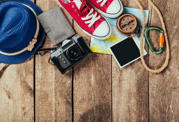 Set of trip stuff on wooden Premium Photo