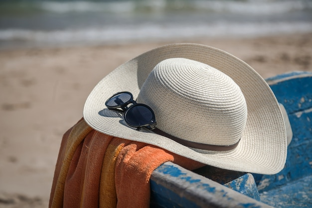 Set of various clothes and accessories for women on the beach Premium Photo