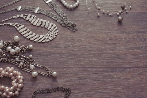 Set of vintage jewelry on a dark wooden background. Premium Photo
