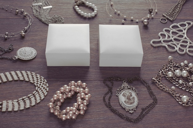 Set of vintage jewelry on a dark wooden background. Premium Photo