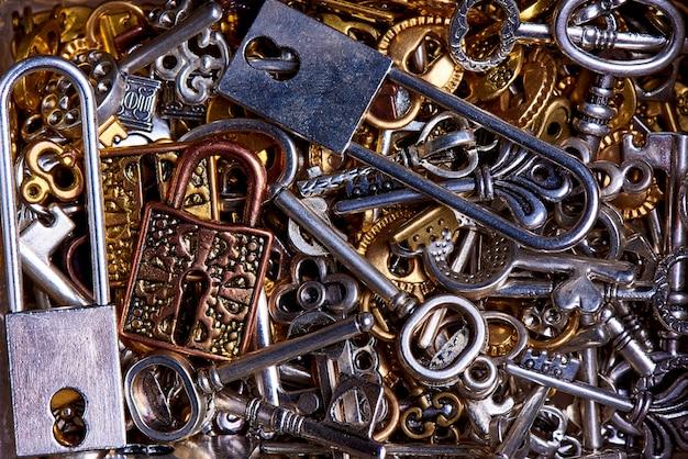 Set of vintage keys and locks close-up. Premium Photo