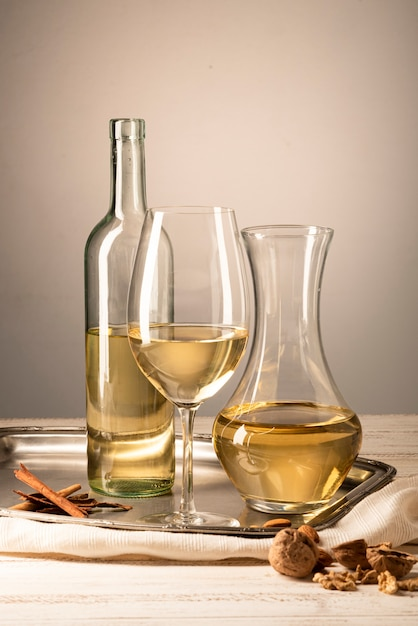 Set of wine bottle with glass and carafe Free Photo
