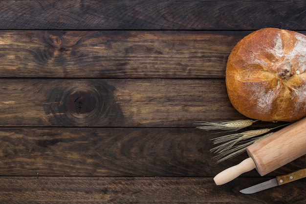 Set with bread rolling pin and knife Free Photo