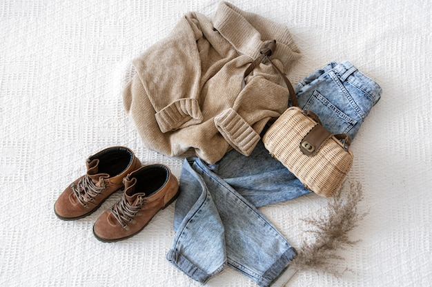 Set with fashionable women's clothing jeans and sweater, shoes and accessories, flat lay. Free Photo