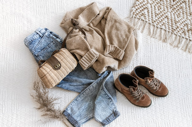Set with fashionable women's clothing jeans and a sweater . Free Photo