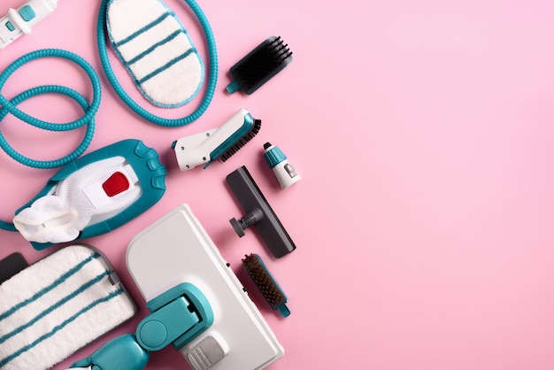 Set with modern professional steam cleaners on pink background. Premium Photo
