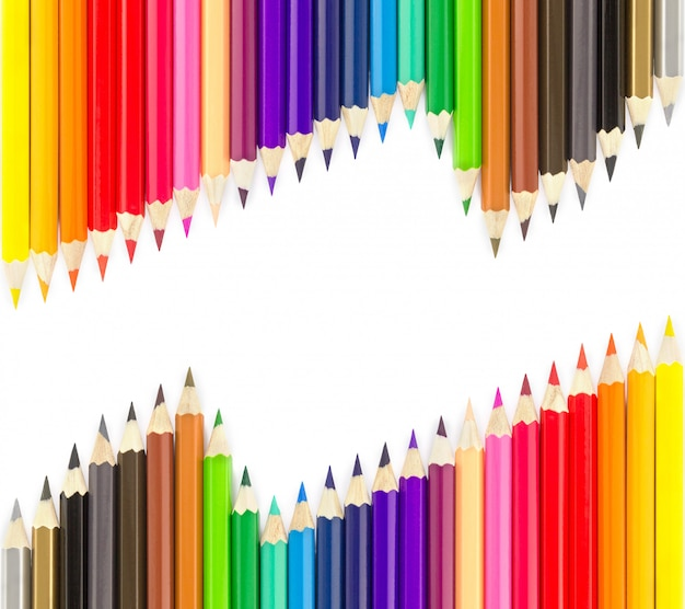 Sets of colored pencils in rows Premium Photo