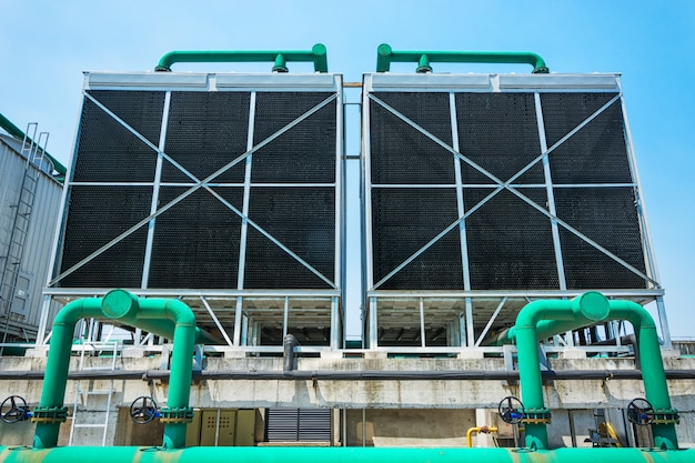 Sets of cooling towers in data center building. Free Photo