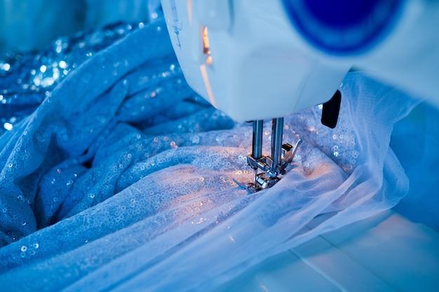 Sew machine closeup hand, sewing Premium Photo