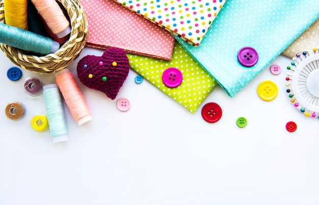 Sewing accessories on white Premium Photo
