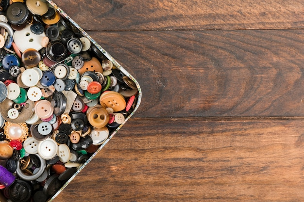 Sewing buttons in a box Free Photo