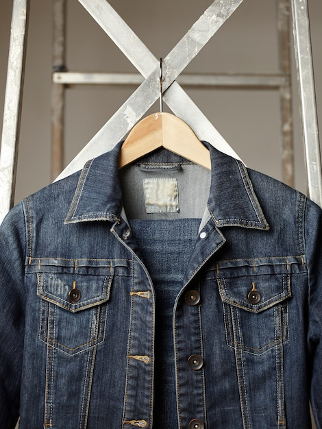 Sewing denim jacket and buttons Free Photo
