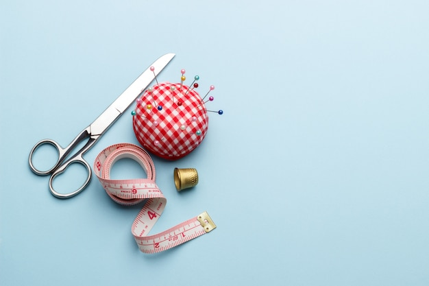 Sewing items on blue Premium Photo