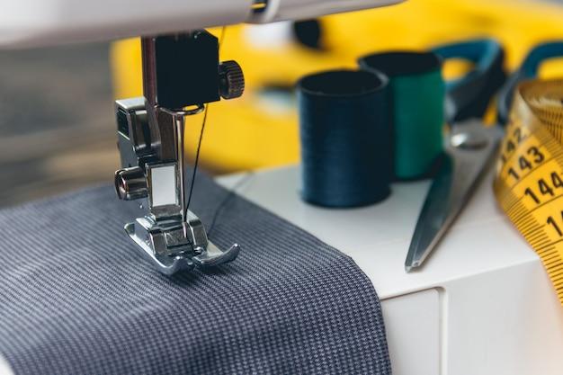 Sewing machine and item of clothing Premium Photo