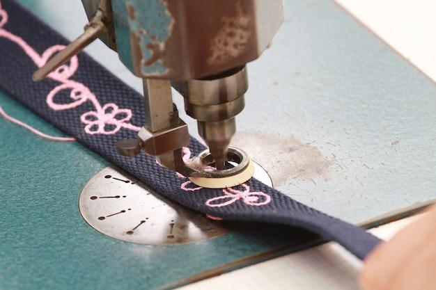 Sewing machine that embroidered written Premium Photo