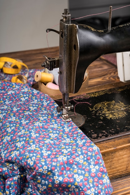 Sewing machine with flower patterned material Free Photo