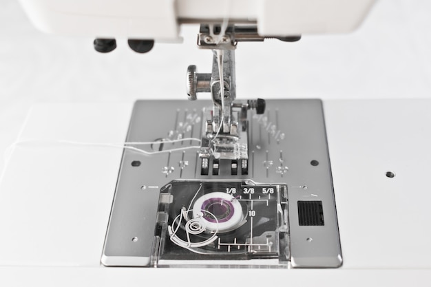 Sewing machine working parts, presser foot needle and spool Premium Photo