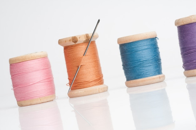 Sewing needle and threads Premium Photo