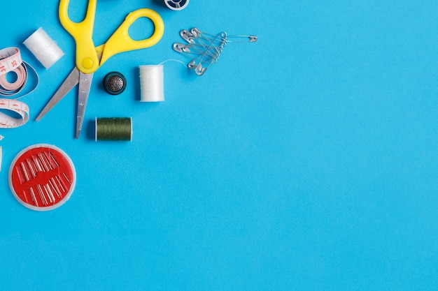 Sewing supplies kit flatlay on neutral background. Premium Photo