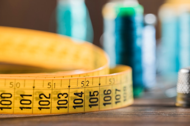 Sewing tape measure with thimble Free Photo