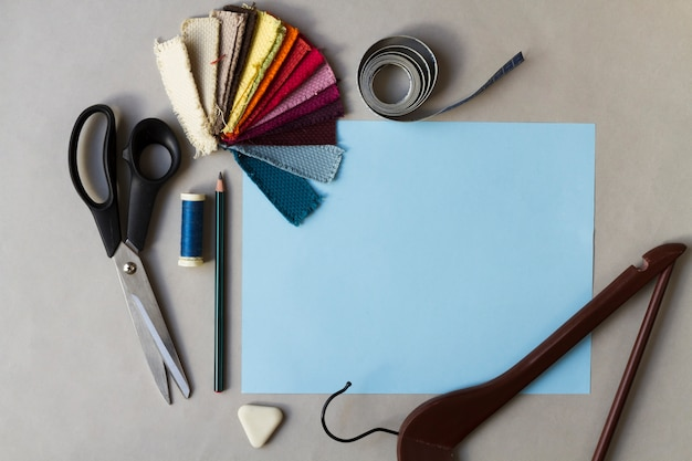 Sewing workplace with sketch and color chart Free Photo