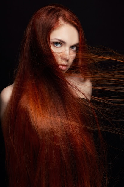 Sexy beautiful redhead girl with long hair Premium Photo