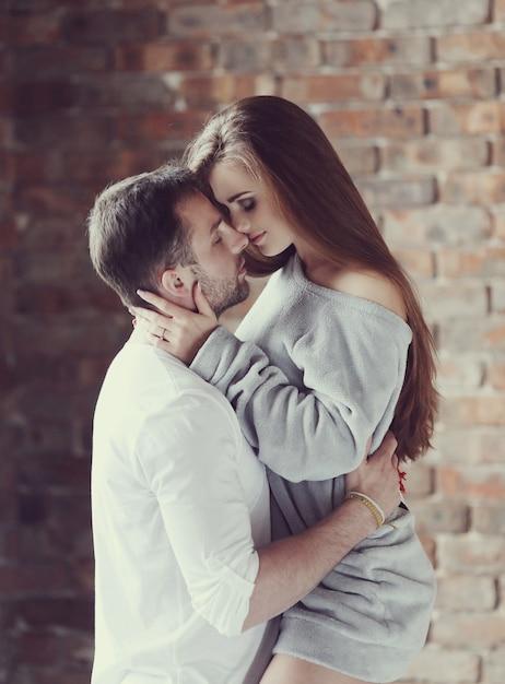 Sexy couple hugging passionately Free Photo