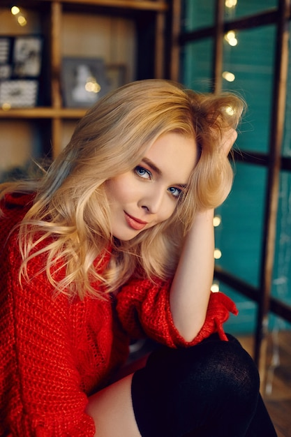 Sexy fashion blonde woman in the red sweater Premium Photo