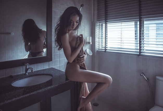 Sexy female in bathroom Premium Photo