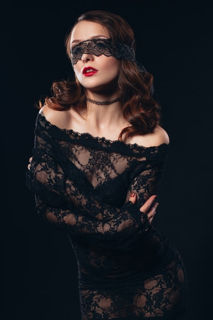 Sexy girl in black mask lingerie on black Premium Photo