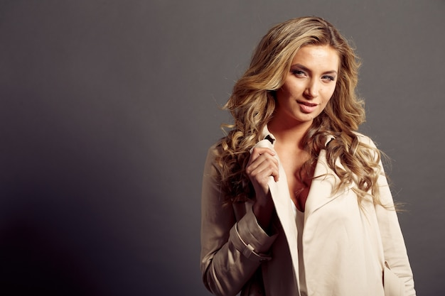 Sexy girl with long blond hair in beige fur coat Premium Photo