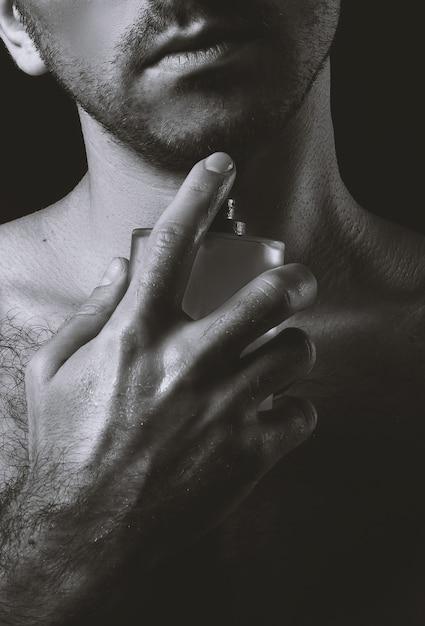 Sexy guy and perfume Premium Photo