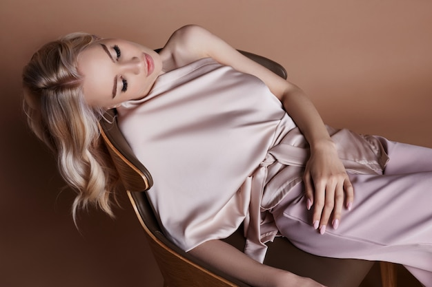 Sexy luxurious woman in a dress. autumn collection Premium Photo