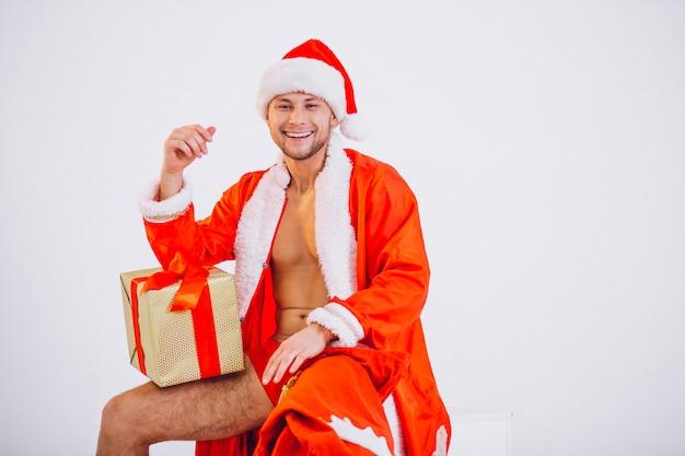 Sexy santa man isolated on white background Free Photo